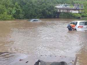 Cars washed away, streets flooded by downpour
