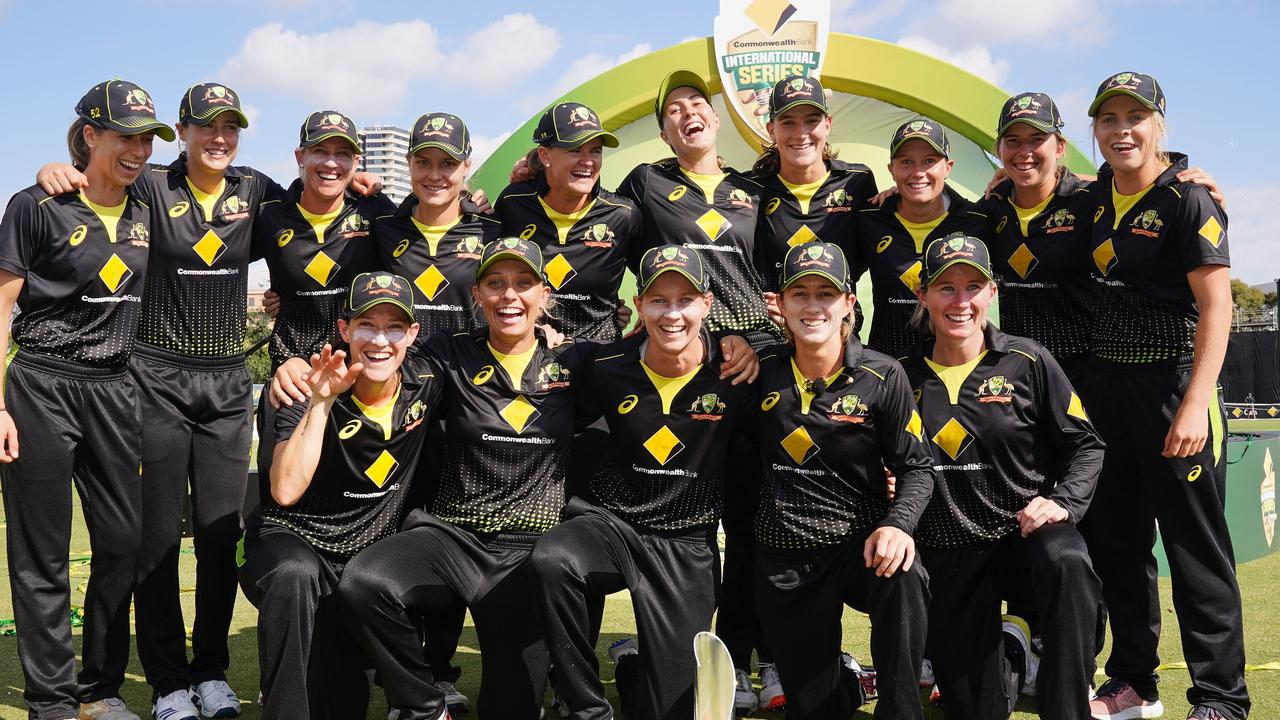 Australian players celebrate the win. Picture: AAP