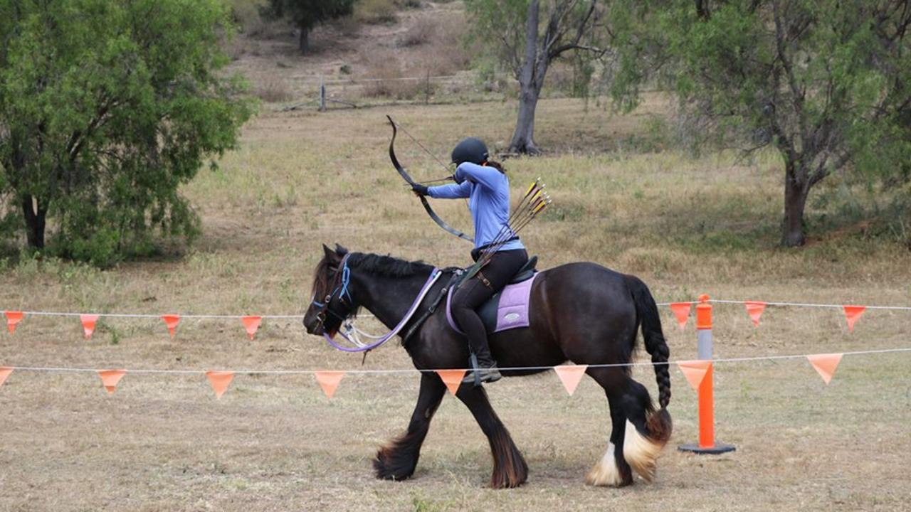 Outback Equine's Carly Richmond shooting her bow and arrow while riding Zephyr. Picture: Contributed.
