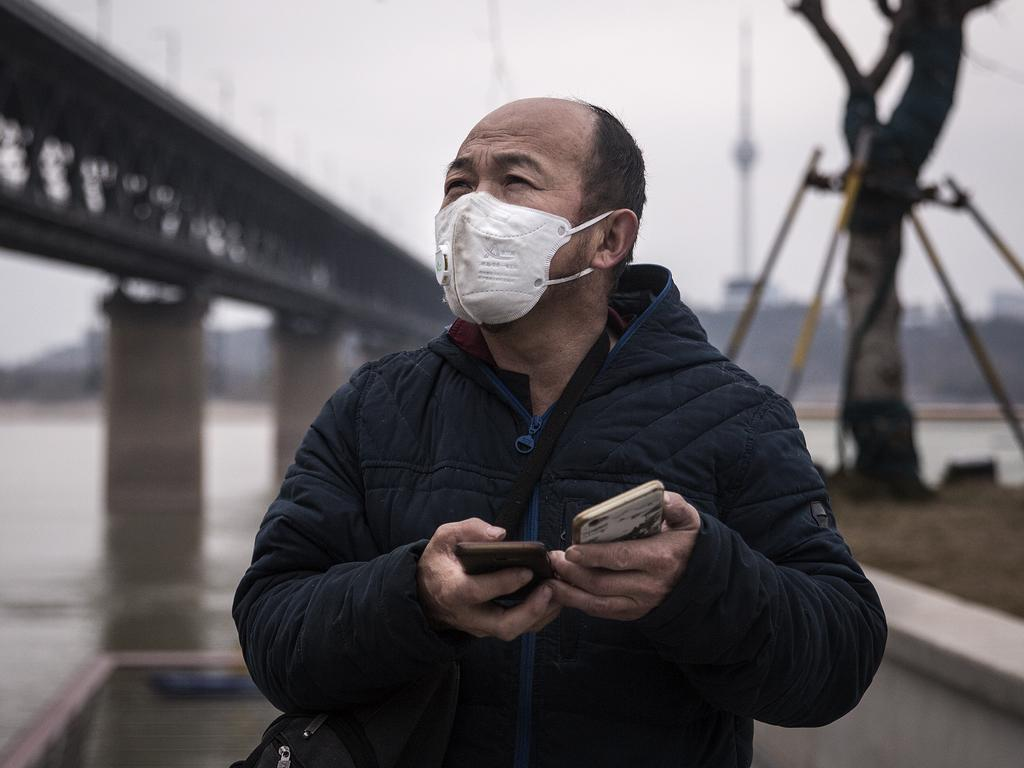 A man wears a protective mask as he stands under the Yangtze River Bridge in Wuhan, Hubei province, China. Picture: GETTY IMAGES