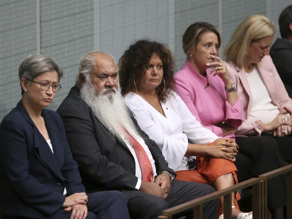 Opposition senators, including indigenous senators Pat Dodson, second left, and Malarndirri McCarthy, third left, listen to Prime Minister Scott Morrison give a speech on indigenous disadvantage. Picture: Rod McGuirk/AP