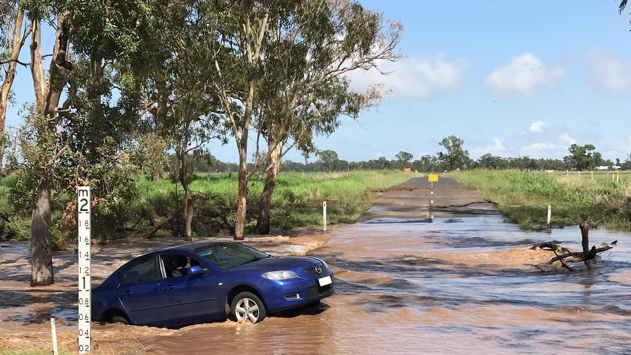 Police warn motorists to not cross flooded roadways after a string of cars were washed on Monday night.