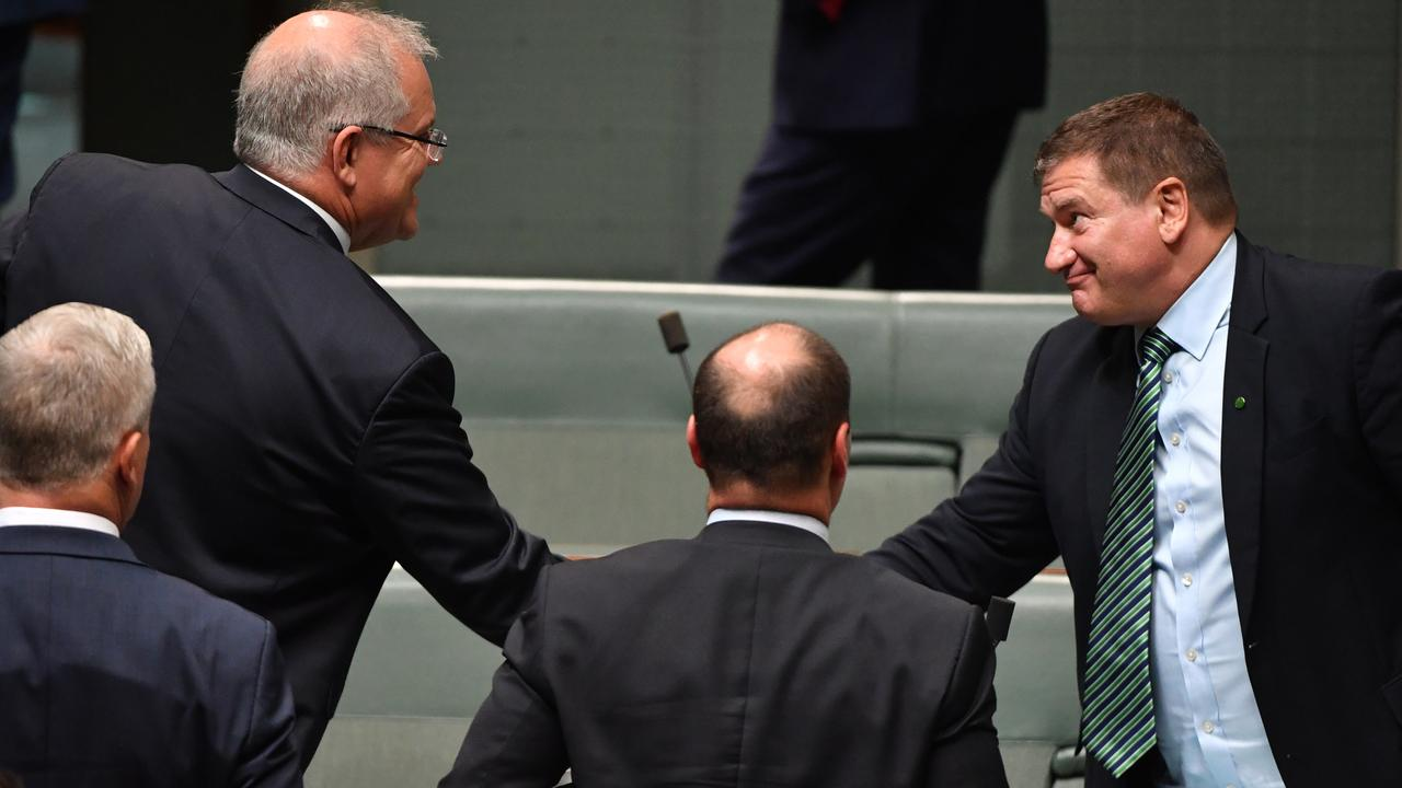 Prime Minister Scott Morrison congratulates Nationals Member for Wide Bay Llew O'Brien after being voted deputy speaker after Question Time in the House of Representatives at Parliament House in Canberra, Monday, Feb. 10, 2020. (AAP Image/Mick Tsikas) NO ARCHIVING