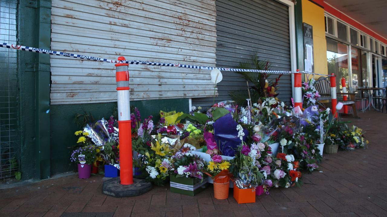 Floral tributes outside the Serves You Right cafe in Ravenshoe in 2015. PICTURE: BRENDAN RADKE