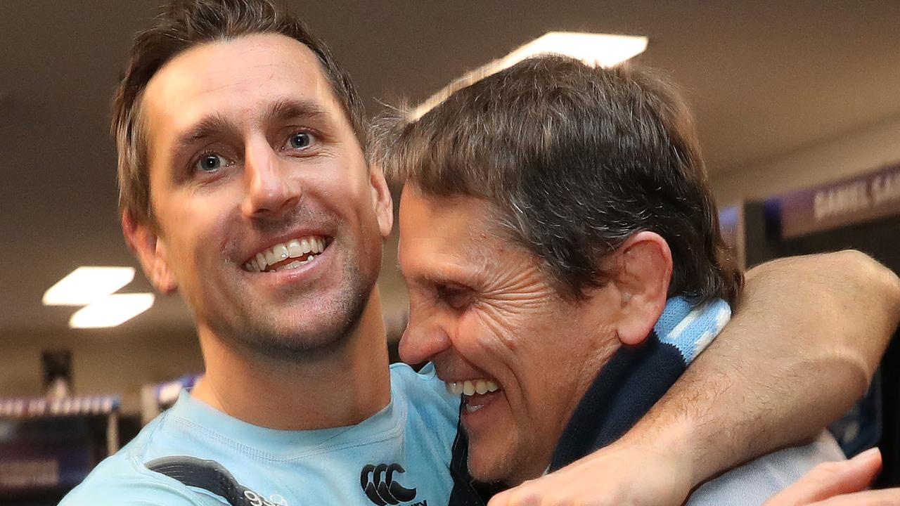 Mitchell Pearce with his father Wayne after the Blues clinched victory in Game 3 of the 2019 Origin series. Picture: Brett Costello