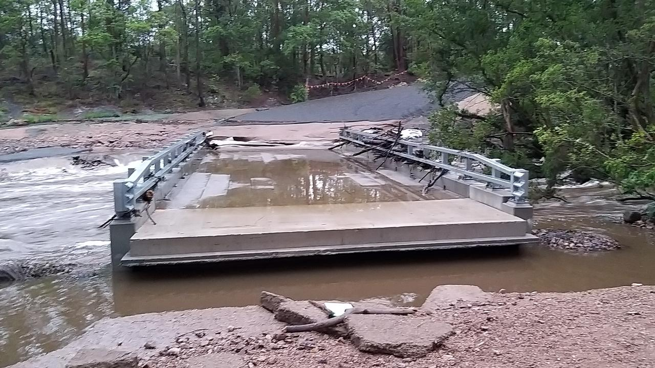 Photos of flooding over the bridge under construction over the south Maroochy River at the junction of Image Flat Road and Kiamba Road.