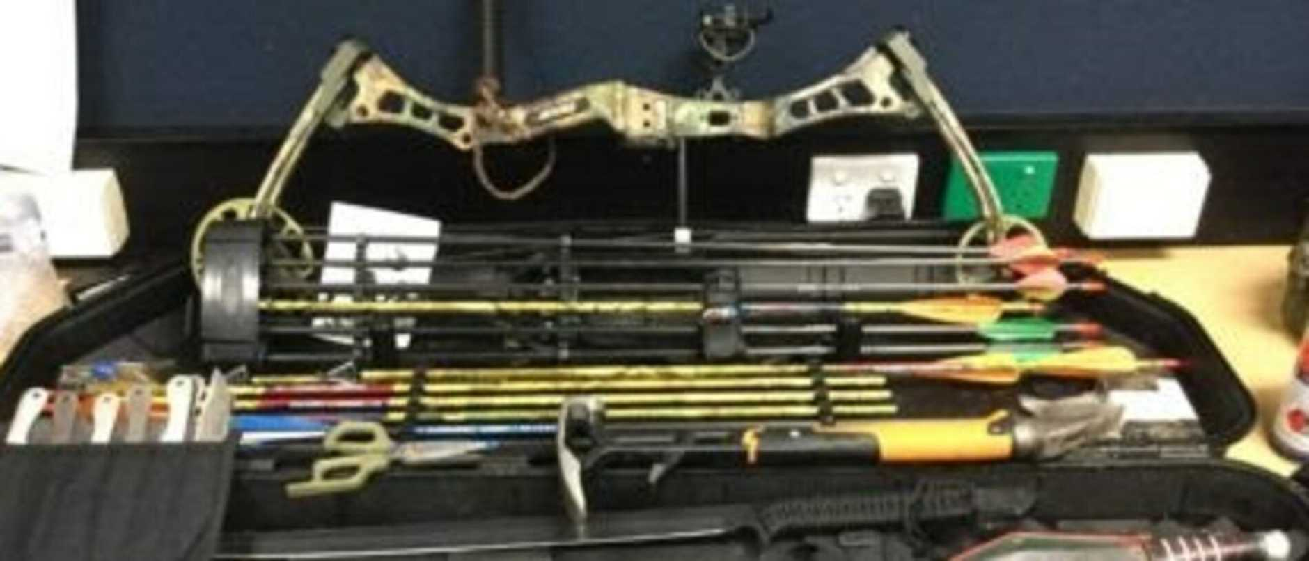 A man has been charged after allegedly being found with a cache of weapons.