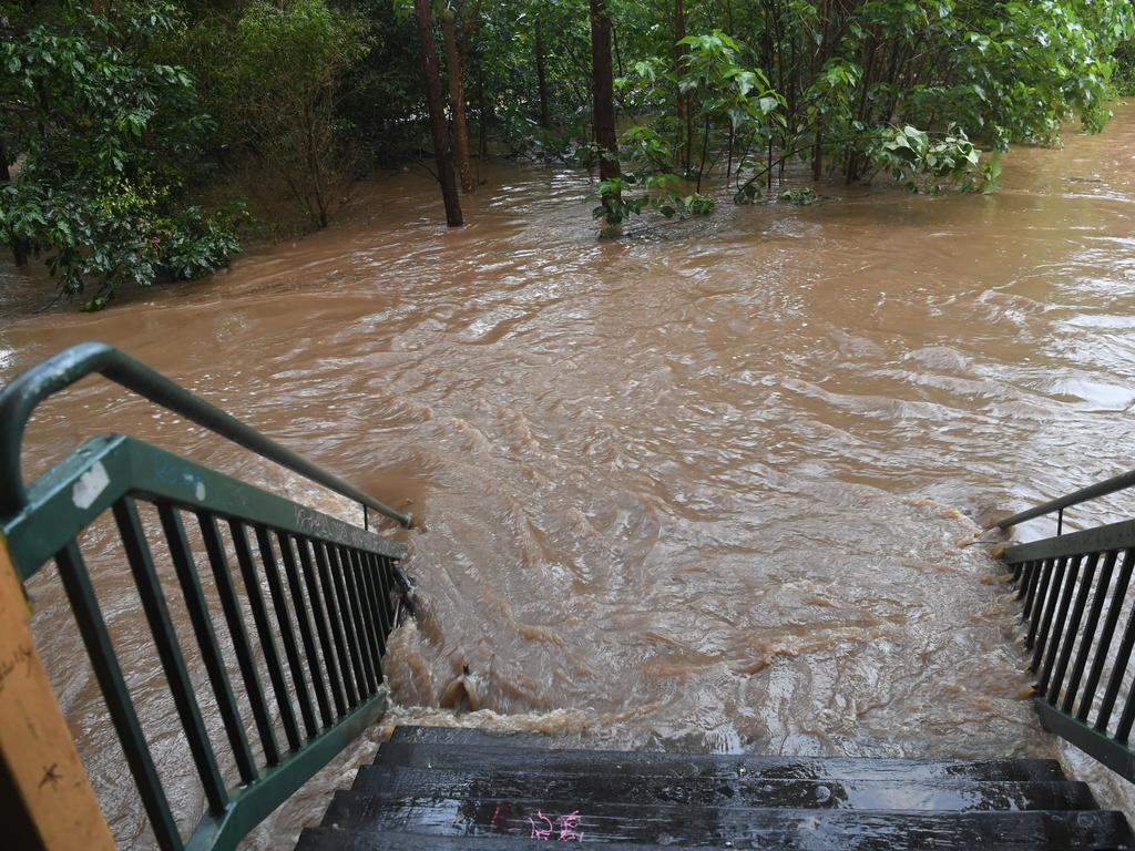 Petrie Creek in Nambour in full flood after 72mm of rain fell in an hour Wednesday night.