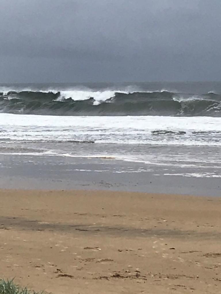 The surf begins to build at Mudjimba as Cyclone Uesi begins to make its impact felt