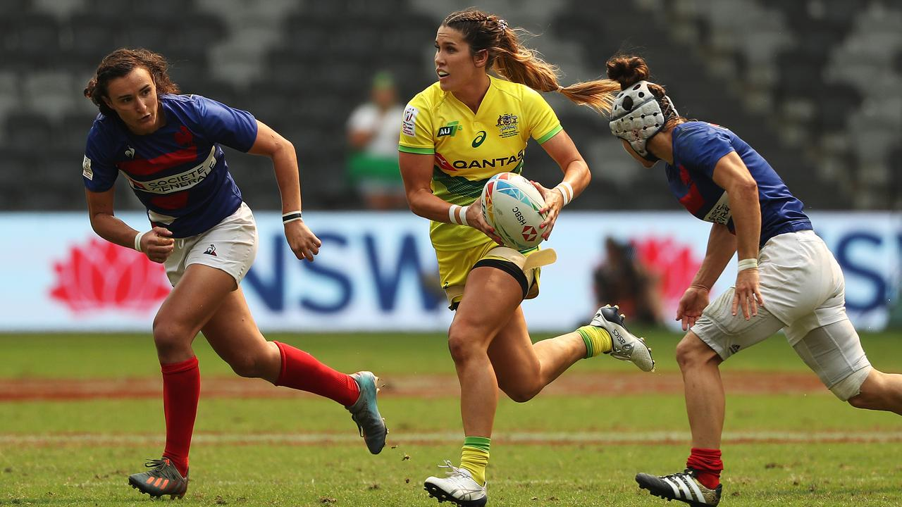 Charlotte Caslick bursts through for Australia against France. Picture: Brett Costello