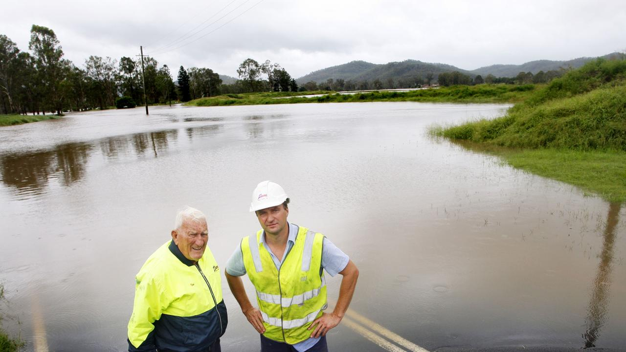 Darren Zanow with his father Viv Zanow asses the situation near their Fernvale quarry just after the 2011 floods. Viv passed away this week.