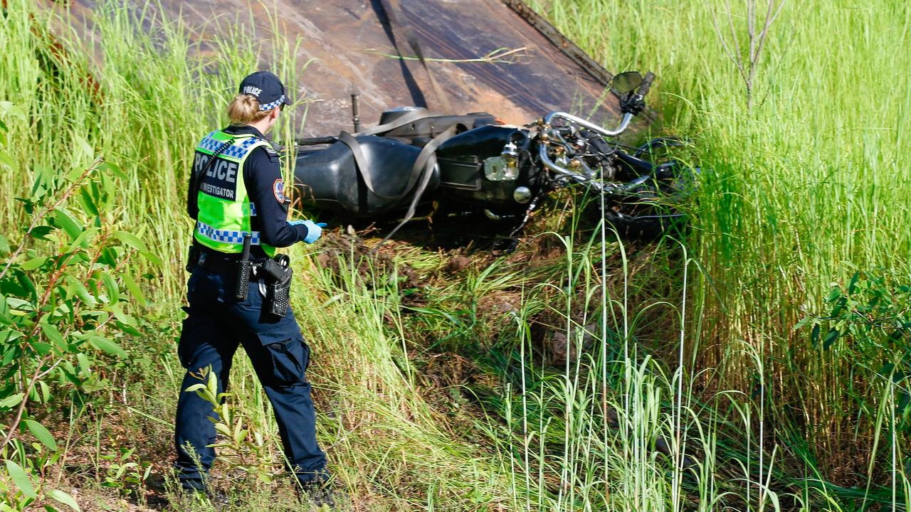 An NT Police accident investigator at the scene of the fatal motorbike accident on Jenkins Road. Picture: Glenn Campbell