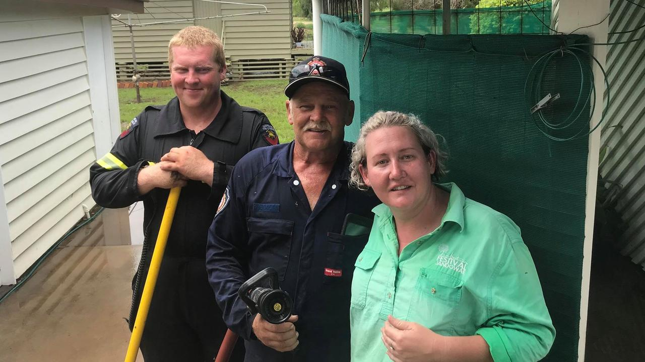 Cleaning up after the flood are (from left) Jandowae Rural Fire Brigade officer Jeremy Liebert and Glen Heathwood and Celeste Nelson.