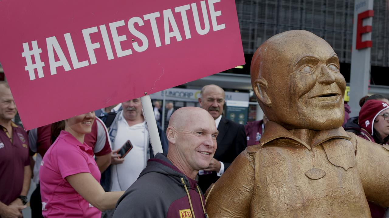 Allan Langer checks out the statue in his honour at Suncorp Stadium. Picture: AAP/Megan Slade