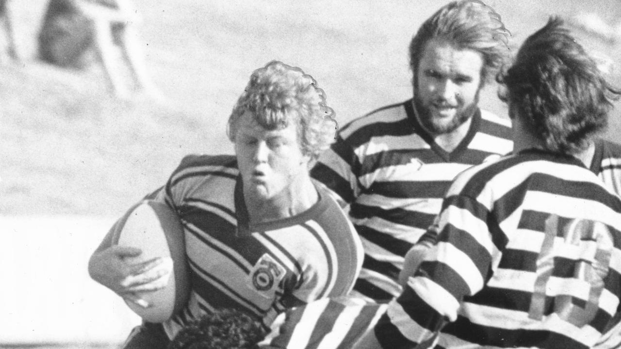 Lock Shane Nightingale on the charge for Brothers in a 1980 club game against Souths with bearded Mapgies prop Phil White in pursuit.