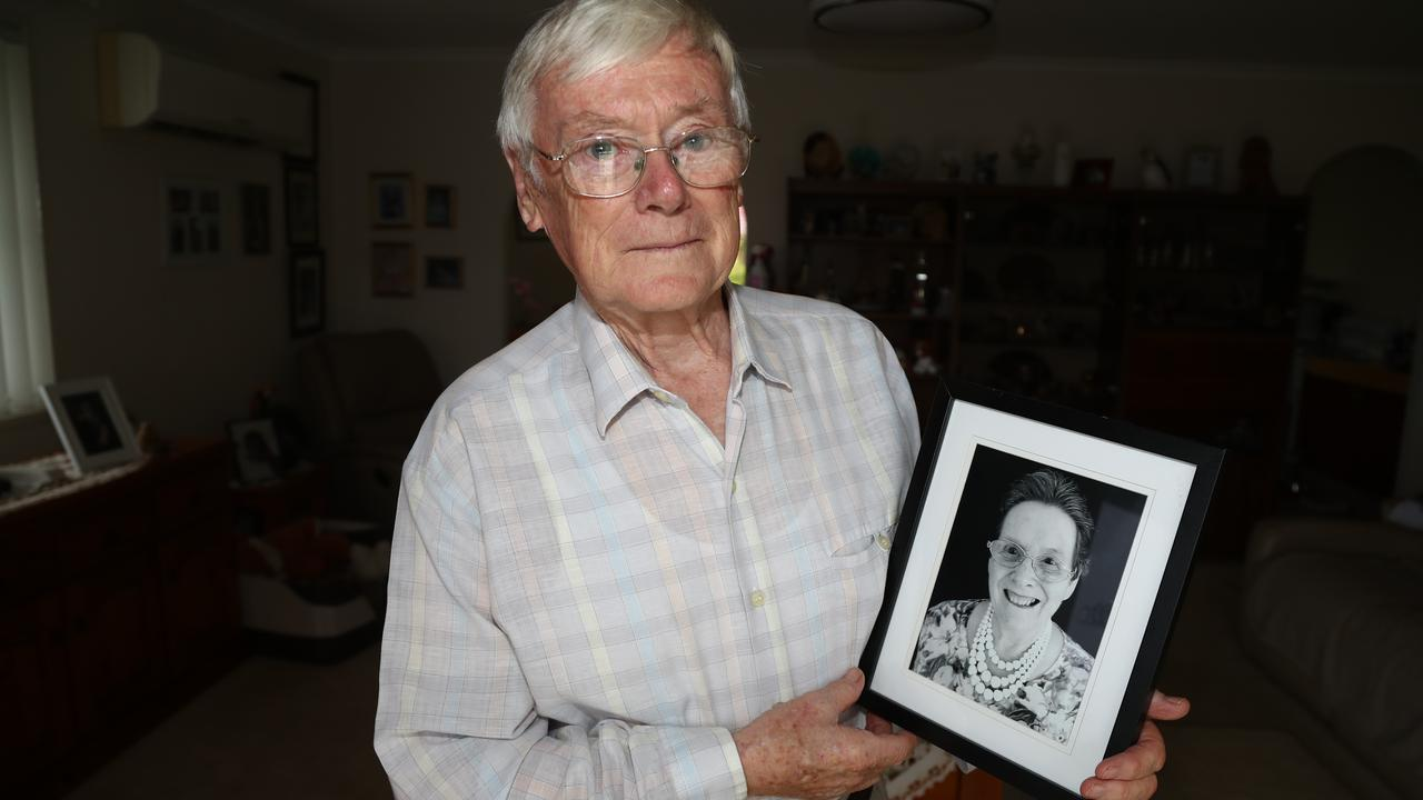 Gold Coast resident Jeff Cruise with a photo of his wife Sheila, who is in a Gold Coast nursing home. Picture: Jason O'Brien