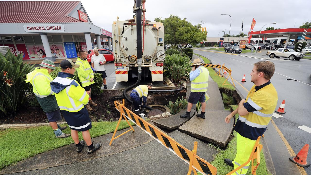 Council staff working on a sink hole that opened up on the corner of Darlington and Leisure drives, Banora Point. Picture: Scott Powick.