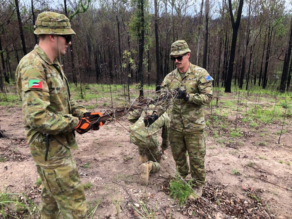 Army personnel help to mend fences in the Orara Valley for BlazeAid after the November bushfires.