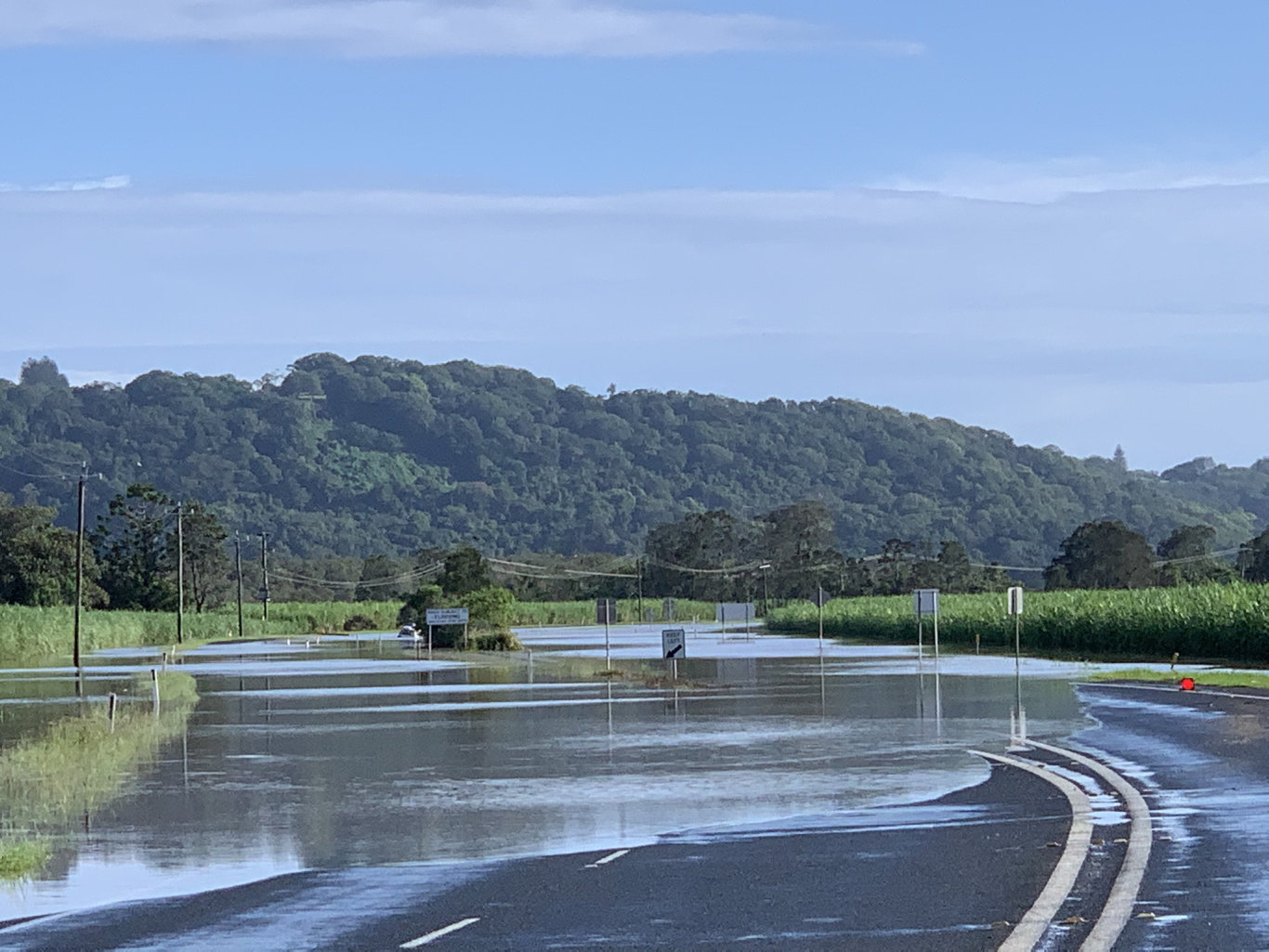 Tweed Valley is completely flooded at Chinderah both north and south bound lanes this morning, Feb 14. Photo: Scott Powick