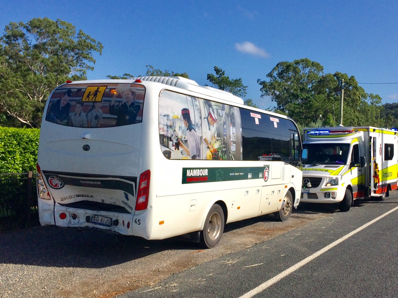 Multiple people are being assessed at the scene of a car and school bus crash at Yandina this morning.