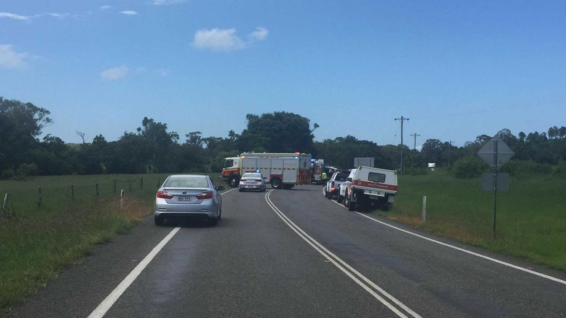 Emergency services at the scene of the crash on Hay Point Road at Alligator Creek south of Mackay.