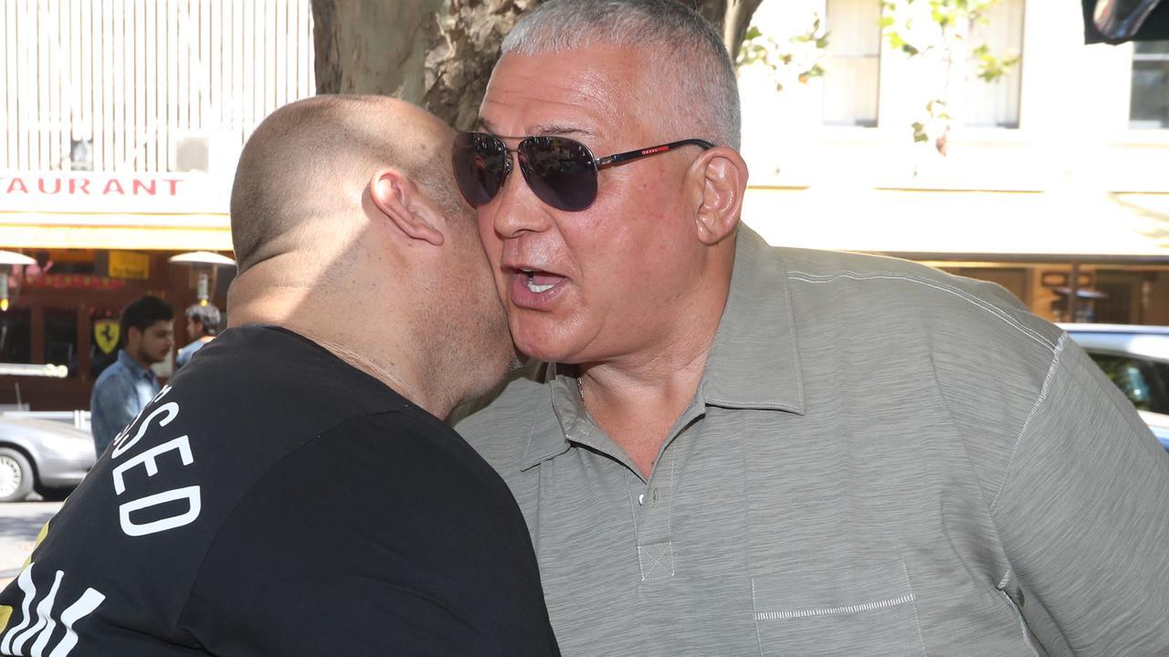 Mick greets Angelo Venditti at a restaurant. Picture: Alex Coppel