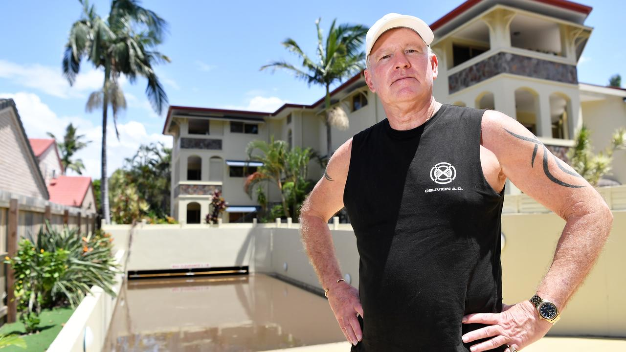 Body corp chairman Keith Symonds in front of the water-filled basement of Nirvana Luxor Apartments, Tanah Road East, Mount Coolum that will cost up to $2 million to empty. Picture: Patrick Woods