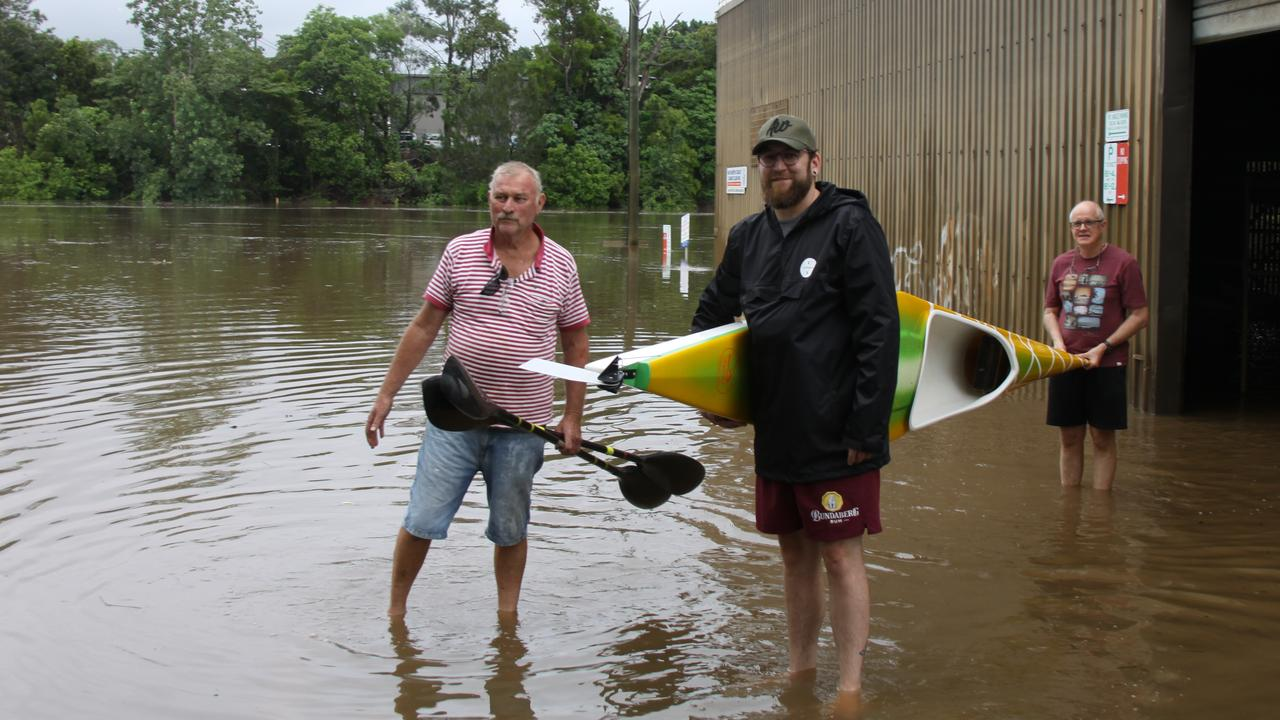 CANOE CLUB: On February 13, 2020, Far North Coast Canoe Club members Geoff Stewart, James Stewart and David Currie remove their gear from the club rooms as the Wilson River continues to rise.