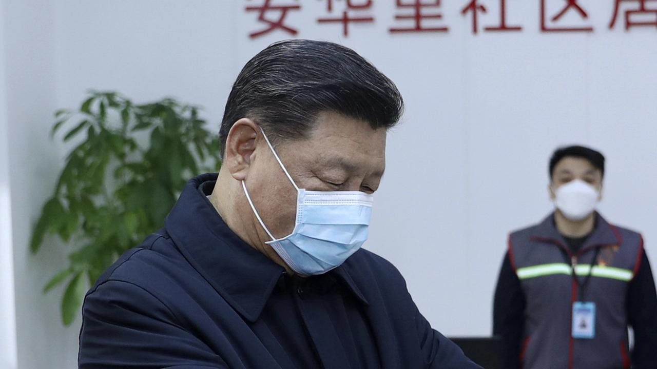 Xi Jinping donned a protective mask during his first public appearance after the coronavirus outbreak — but it carried a subtle message. (Pang Xinglei/Xinhua via AP, File)