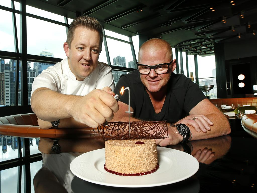 Chefs Ashley Palmer Watts and Heston Blumenthal light the sparkler on the birthday cake to celebrate the first anniversary of the restaurant at Crown. Picture: David Caird