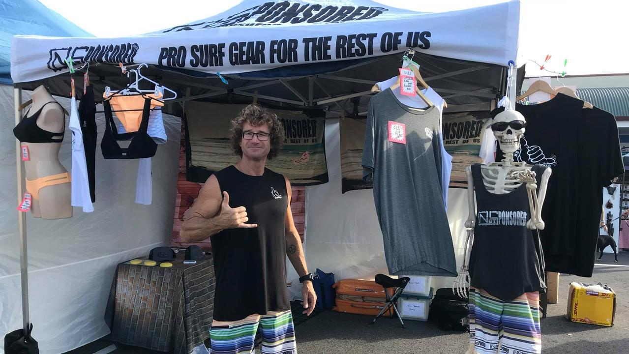 Brad Manuel with some of the Not Sponsored sustainable swimwear and beach items.