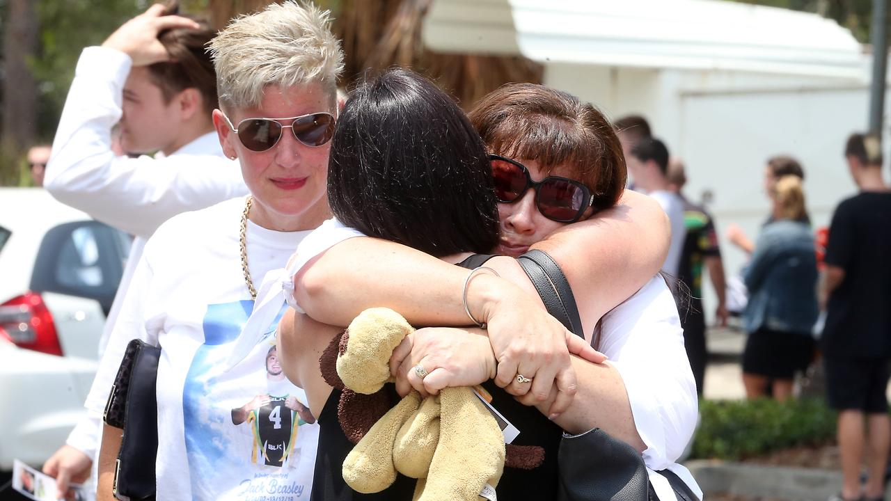 Jack's mother Belinda Beasley is embraced by a mourner at his funeral. Picture: AAP.