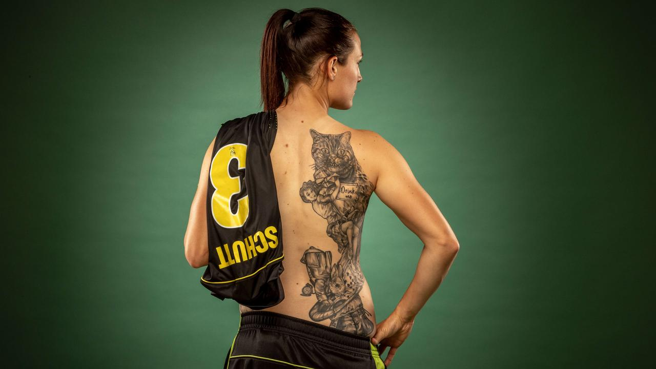 Australian cricketer Megan Schutt has a large tattoo depicting Alice in Wonderland that runs down one side of her back. Picture: TIM CARRAFA