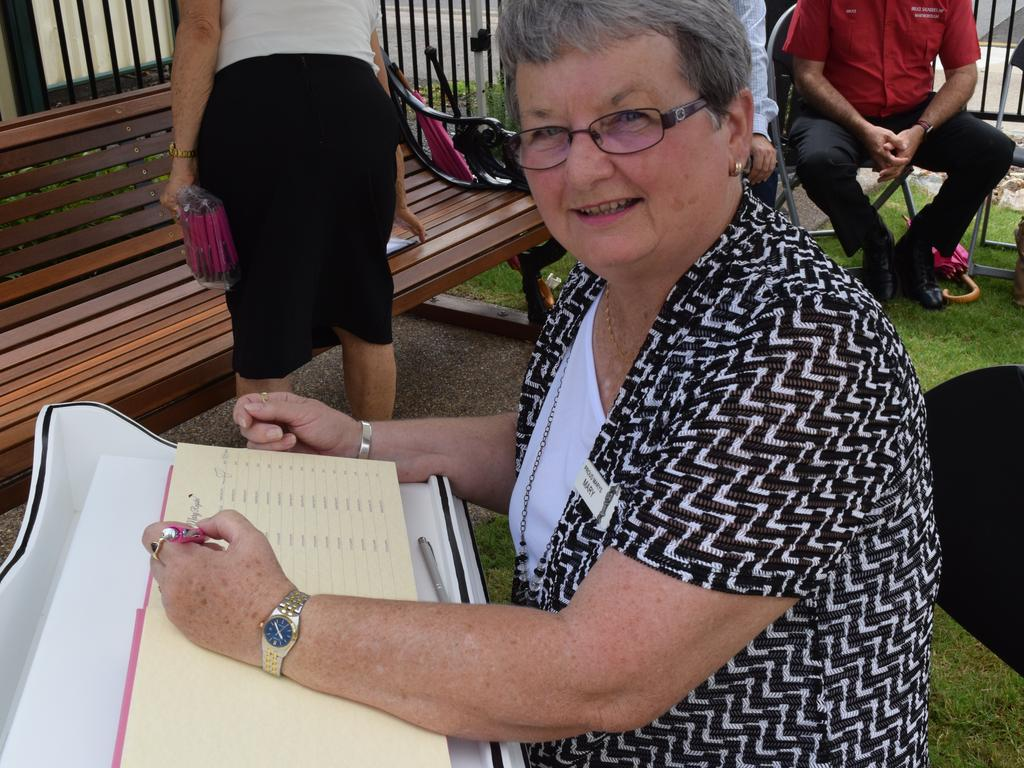 Mary Register: First signatory Mary Lange signs the new Mary register at the Story Bank, Maryborough. Photo: Stuart Fast