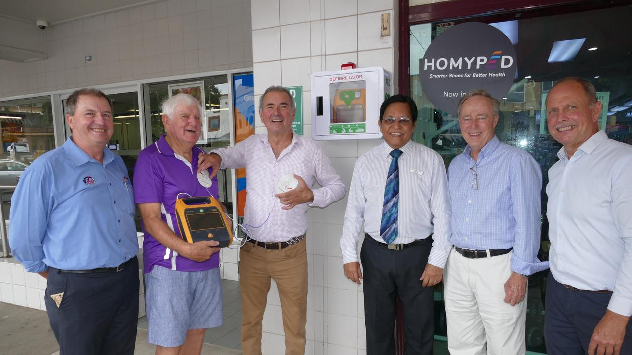 Grafton Midday Rotary president Robert Blanchard, immediate past president Bob Booth, Clarence MP Chris Gulaptis, pharmacist Kishore Chand, Chamber of Commerce member Des Harvey and owner of defibrillator distributor Heartsafe Medical Solutions Phil Smith after the installation of one of six defibrillators in the Grafton CBD outside Friendlies Pharmacy in Prince St.