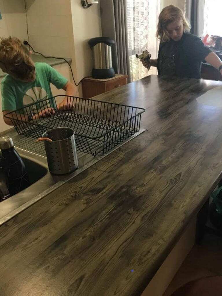 After the makeover, the kitchen bench could have easily passed for an entirely new piece. Picture: Facebook