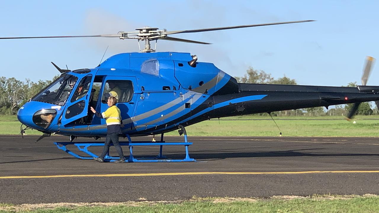FLYING HIGH: CS Energy employees using an alternative way of transport to get to work this morning.
