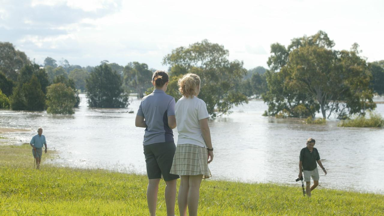 FLOODING FLASHBACK: The Condamine River flowing over Wallace Street Bridge after floods in 2008.