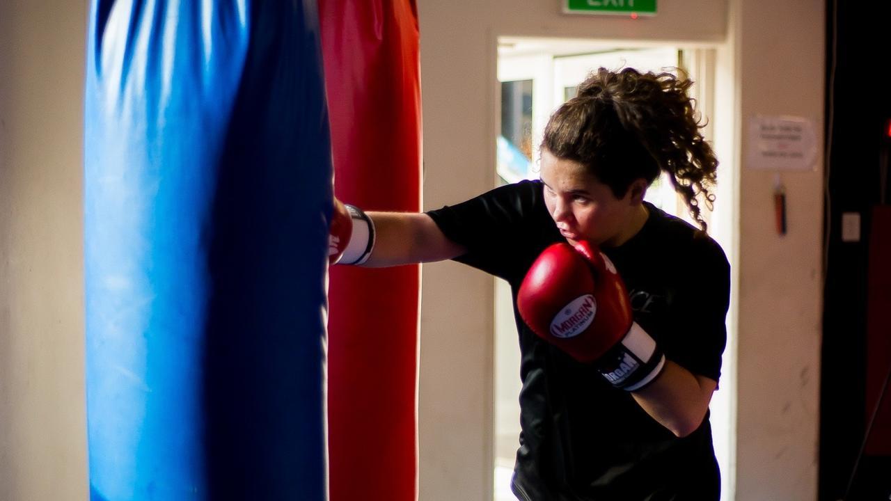 FIGHT: Kristen Meek kept her autism a secret for fear of bullying. Photo: Katrina Elizabeth Photography