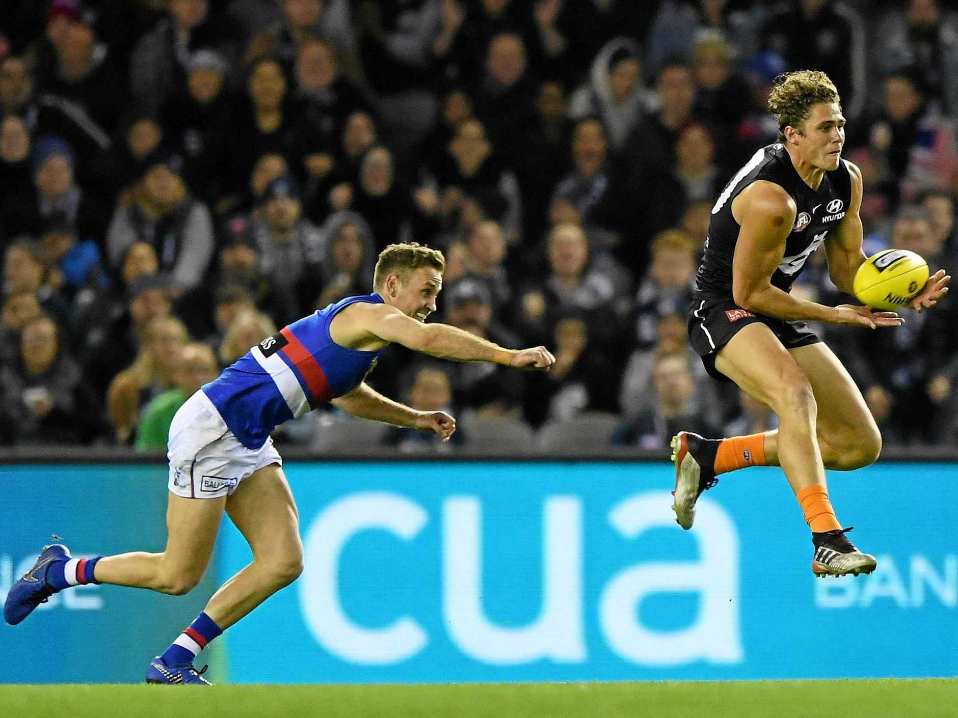 Carlton's Charlie Curnow marks in front of the Bulldogs' Hayden Crozier on June 15 last year. Picture: Julian Smith/AAP