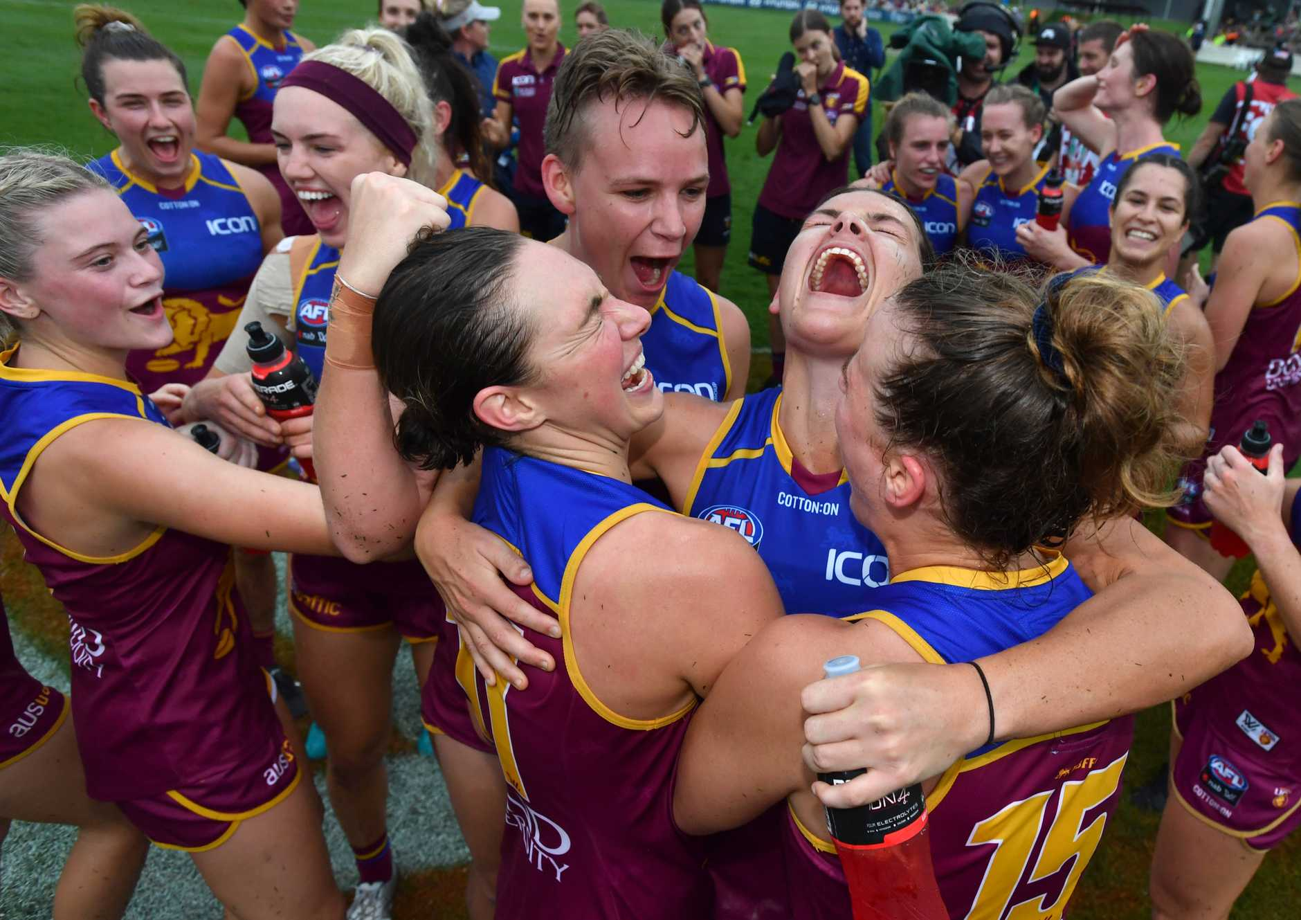 Lions celebrate the win over the Crows.