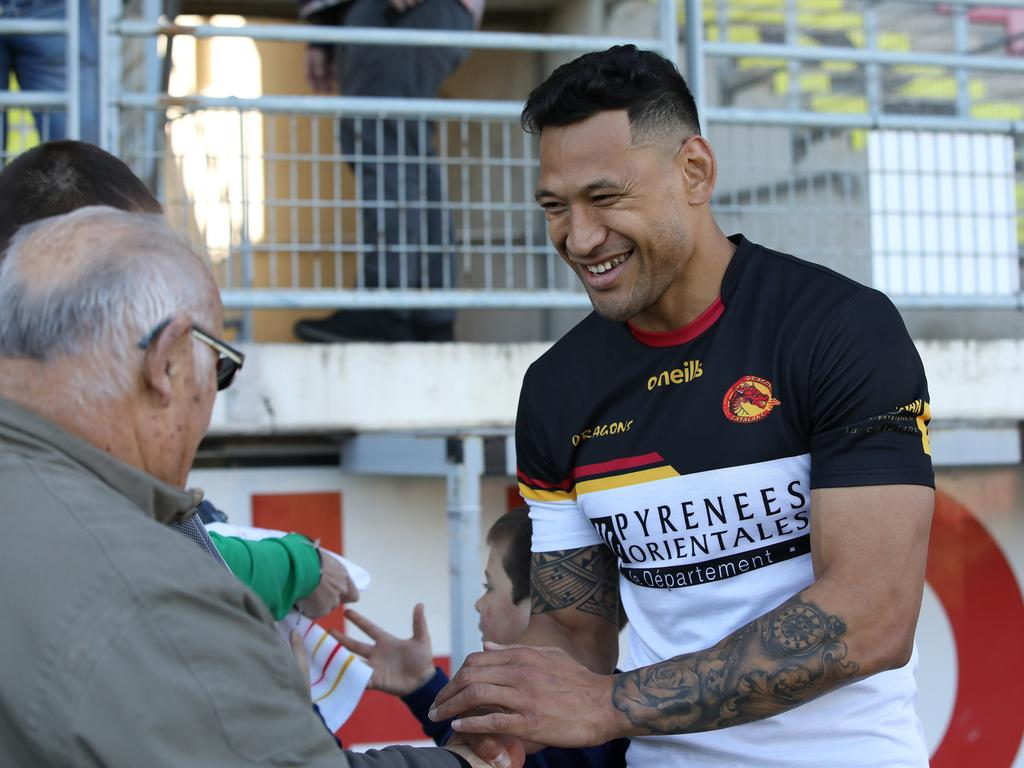 Israel Folau meets supporters after training with Catalan Dragons in Perpignan, France. Picture: Ella Pellegrini