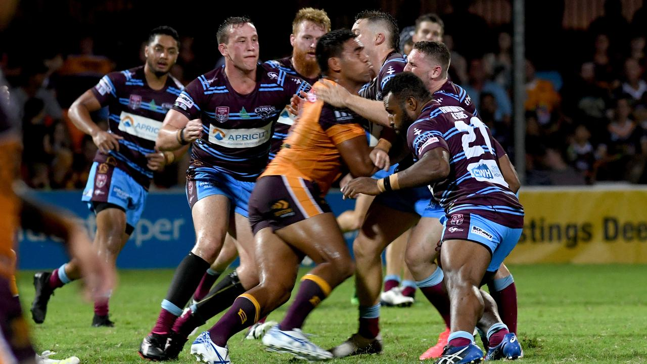 MUSCLING UP: Brisbane Broncos' Joe Ofahengaue is met by some willing CQ Capras defence in tonight's trial game at Browne Park.