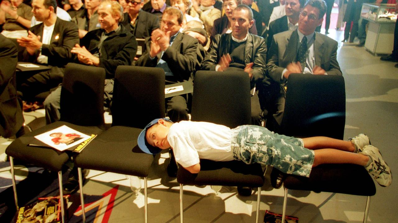 Tim Tszyu, 7, has a rest during his dad's press conference in 2002.