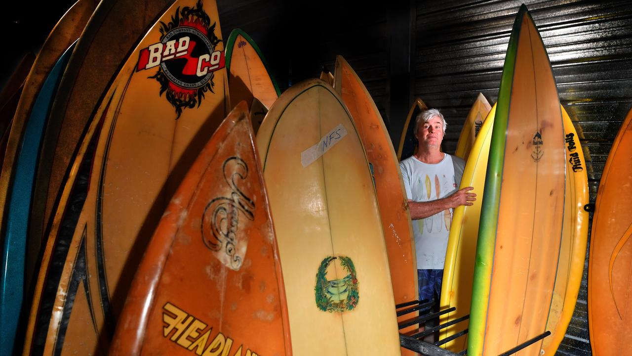 Lloyd Fresser with dozens of old and classic surfboards up for sale. Photo: John McCutcheon / Sunshine Coast Daily