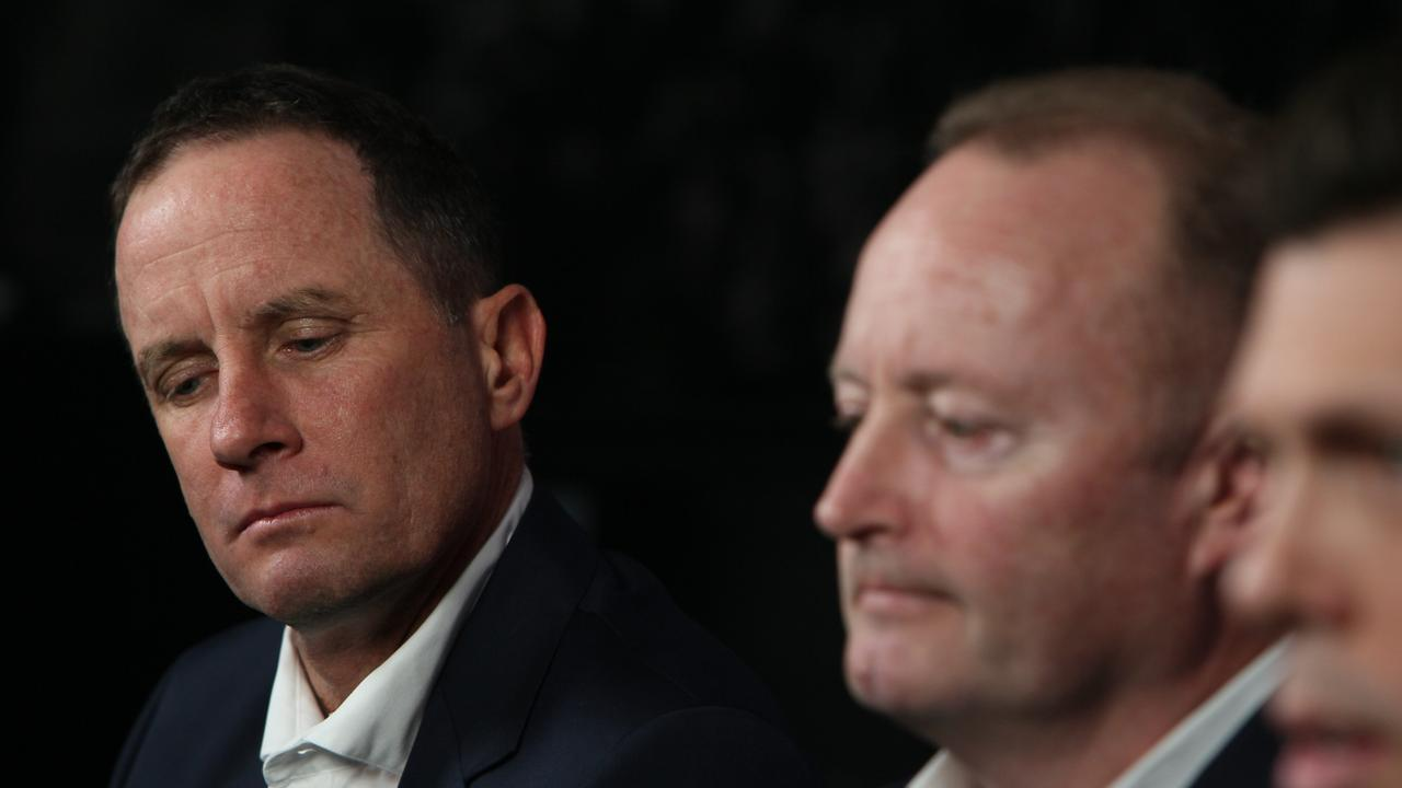 Don Pyke, Adelaide Crows chairman Rob Chapman and CEO Andrew Fagan talk to media about Pyke's decision to step down as senior coach. Picture: Emma Brasier/AAP