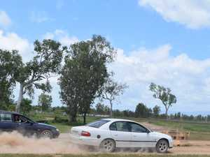 Cars kick up dust in head-to-head racing
