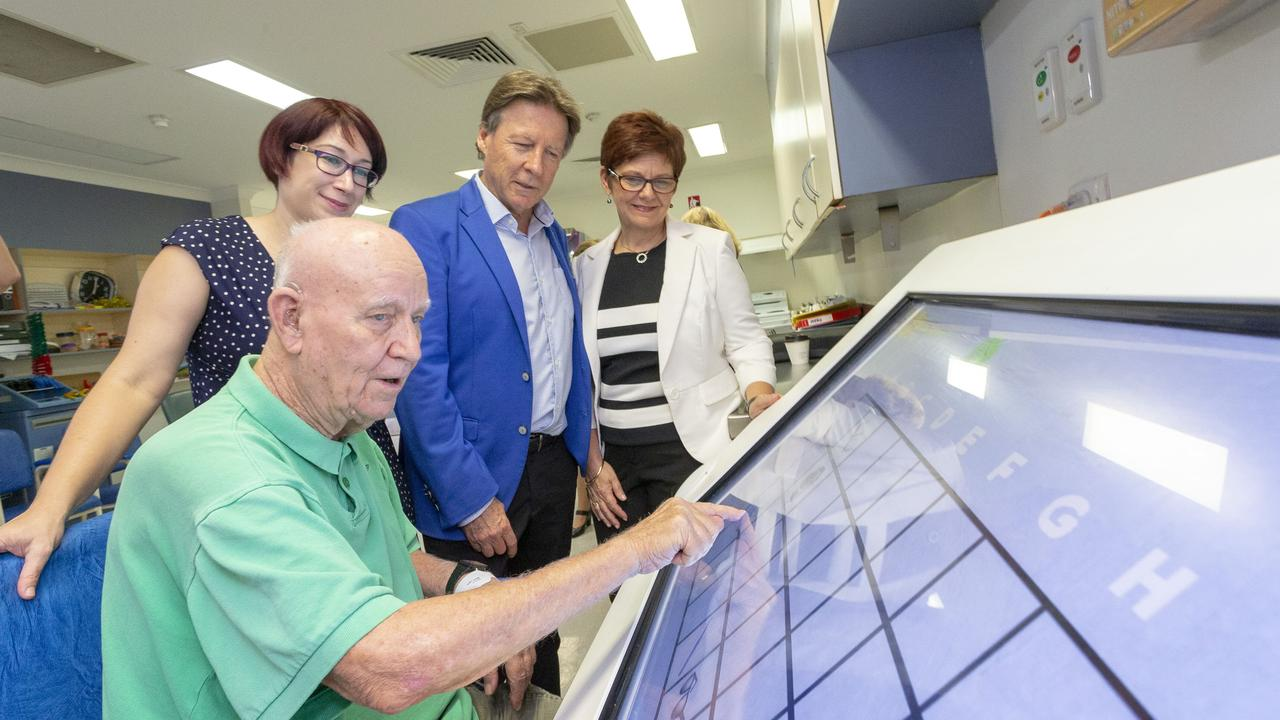 Colin Wheeler demonstrates touch screen robotics device for cognitive and motor coordination for Dr Phoebe Slape, Mayor Tony Wellington and Eden CEO Jo Munday.