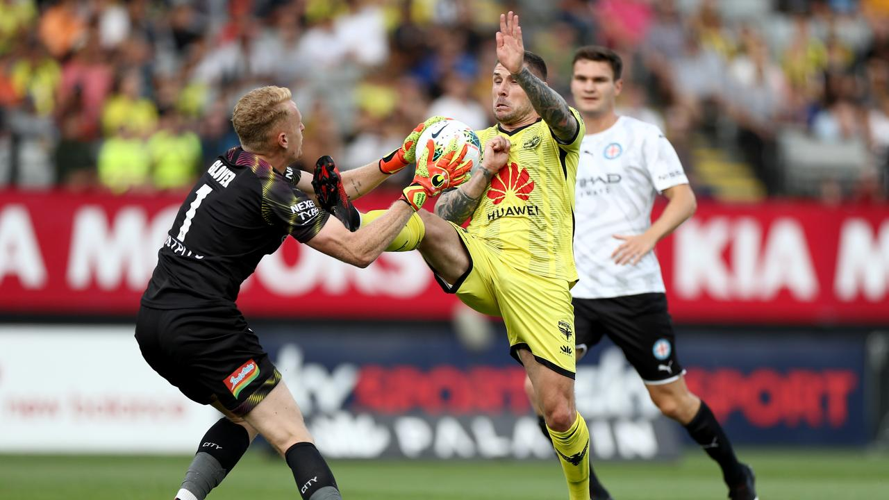 Tom Glover deals with the ball — and a boot — from Phoenix's Gary Hooper. Picture: Getty Images
