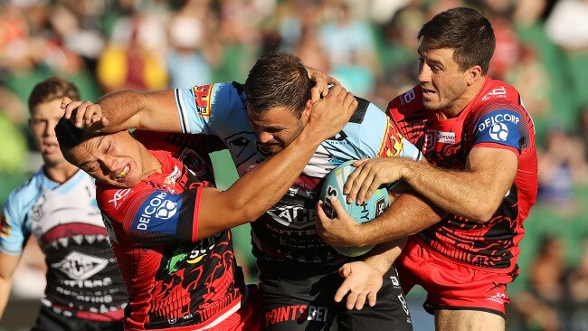 Wade Graham of the Sharks fends off a tackle by  the Dragons'  Tyrell Fuimaono on day one of the 2020 NRL Nines. Picture: Paul Kane/Getty